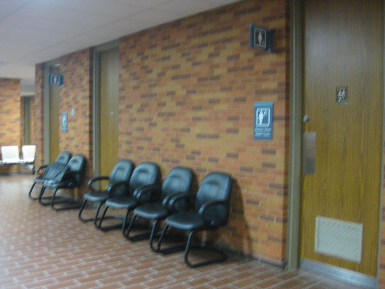 Interior washroom accessibility retrofit, Barrie Courthouse.