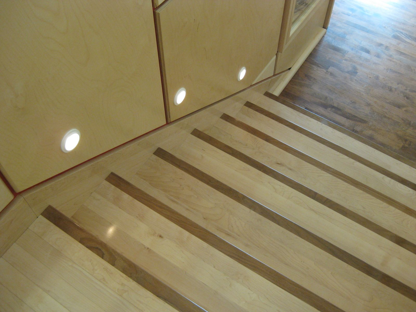 Colour contrasted wood stair nosings and feature lighting at tread level