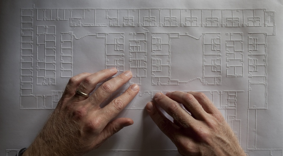 View of tactile floorplan being read by Architect Chris Downey (Credits: Fogg Studio, Chris Downey, The Atlantic Citylab)