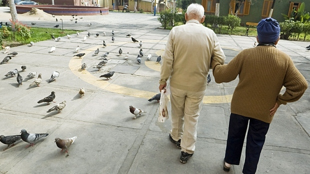 Two seniors walking in park